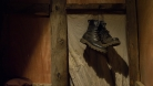 In Tibetan tradition hanging your foot ware in front of the door signifies a couple having sexual relationships