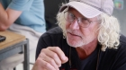Jim Adamson, University of Miami (UM) School of Architecture's build critic, speaks with Rocco Ceo, UM professor, about the eco-tent's pole system and design.