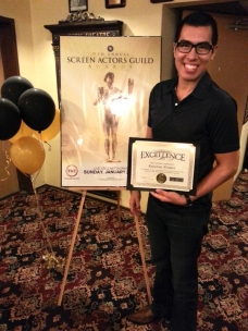 Krisstian de Lara receiving South Florida SAG Award Recognition