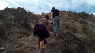 You're Gone Behind the Scnes - Tania and Krisstian climbing up a mountain