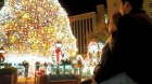 A lovely couple enjoying of the biggest decorative lighting tree in the city of El Paso.