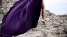 Tania models a purple corset dress in a high elevated deserted mountain nearby the USA and Mexico border.